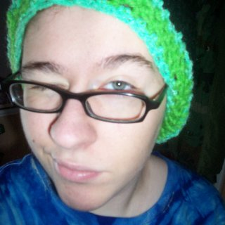 Lol I look funny with my hair in my hat. This hat was handmade by crocheting three different colored yarns :)