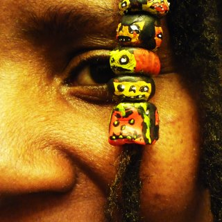 Just experimenting with polymer clay and made some dread beads. I just wanted some color and character added to my dreads. Why not a bunch of silly looking ghoulies