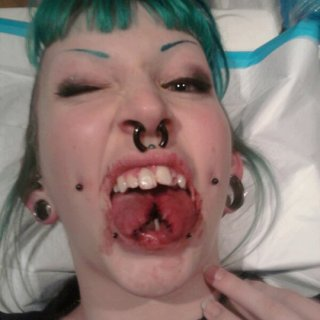 I finally got the balls to go ahead and get my tongue split! It's gory, but I love it!