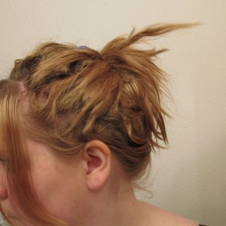 """A cute way I found to put my hair up. Works well with different """"stages""""."""