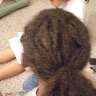 my 6 yr old nephew getin his first loc, we have neva cut his hair and now his locking journey begins! i got to do the honors! (rip n twist)