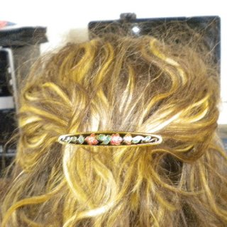 I got this clip from an Irish woman at a craft bazaar here in Germany. I thought it was so old fashioned looking and beautiful, so I wanted my dreads to have it!