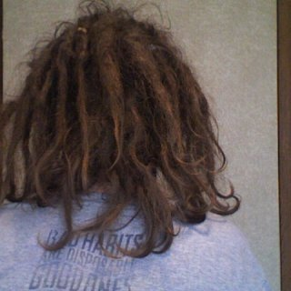 "July 12, 2011 aka day 174 of my knotty hair! Back of my head. Shirt says ""bad habits are disposable good habits are reusable"""