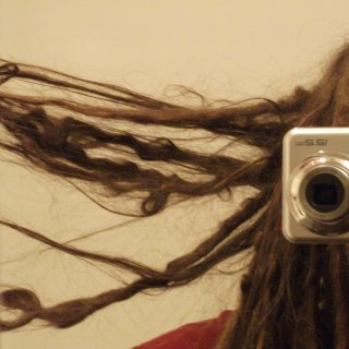Here are some of the crazy things that happen to hair when it doesn't see a brush for 8 months...