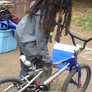 He doesn't like to take pictures a lot but I begged him to get a photo of him and his awesome freeform dreads and his bike on our camping trip in Fort Bragg Ca.
