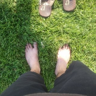 amazing how cool watered grass feels on a kinda warm day, you know, after a walk n all :)