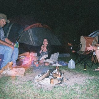 my papa and my love sittin 'round the ol' campfire ;)
