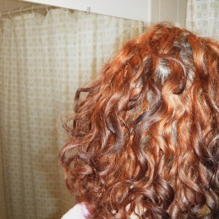 No, that's not a bald spot. That's where I moved curls aside so you can see how the roots are starting to lock up.