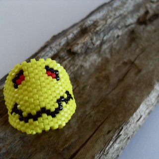 "This dread sleeve is two sided featuring a smiley with an ""altered"" psychological state while the other side shows the results of said ""altered"" state... this is like 2 sleeves in one!  http://www.etsy.com/listing/86978134/peyote-sleeve-dread-bead-decoration"