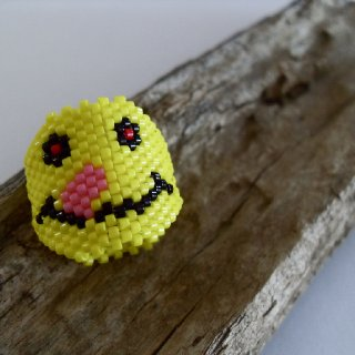 This is the other face of the double sided peyote sleeve featuring the smiley with the munchies... feed him! Now you can slide the dread bead around depending on which face you want to be seen!  http://www.etsy.com/listing/86978134/peyote-sleeve-dread-bead-decoration