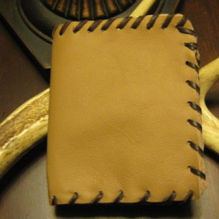 I am making all the Christmas presents this year. I was trying to think of a guy gift I could make for my son and I thought about a wallet. I had scrap leather and did this tonight. It was a bit of a challenge but it was fun to make.