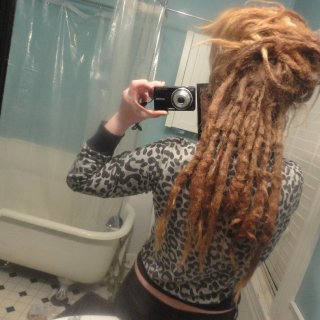 actually under these i have about 6 cute little whispy new-growth dreads around 5 inches long!