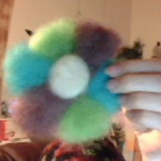 My first ever attempt at needle felting. Ashland, OR wool roving dyed with kool-aid and somewhat shaped into a flower lol. I wanna make it into a hair piece either a barrette or a tie or something... please excuse the poor webcam quality.