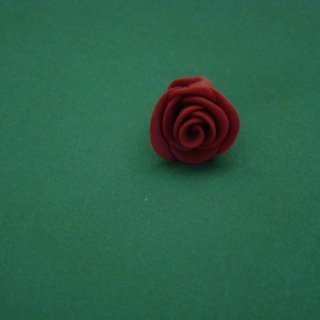 "This dread bead was made using two-toned red mixed polymer clay and formed into a rose shape. The inner hole diameter is 3/8"". For sale in my Artfire store."
