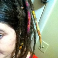 2ish months added a little roving wool to two dreads