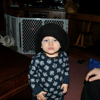 Little man wearing Daddy's crocheted tam, which was made by me :)