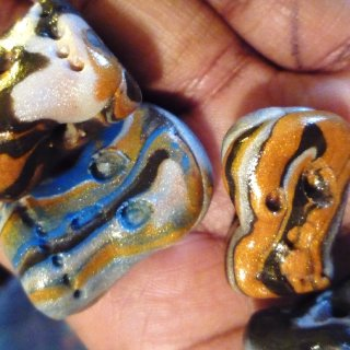 I have been making a lot of dreadlock beads and just regular beads for jewelry making or purses and craft projects.