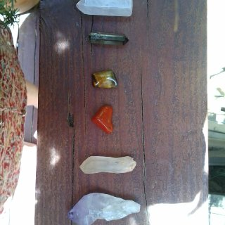 Rose quartz, one I forgot, tiger's Eye, blood stone I think, citrine, amethyst. I hand wrap these in silver wire.