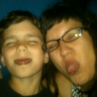 Devlin and I are waiting to watch a movie at the cinema and having fun being cheese balls in the empty theatre.