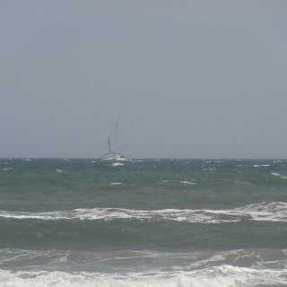 was just testing the zoom on this 1 this sailboat was miles out ..right at the horizon i couldnt even see it in the viewfinder and didnt have a tripod so im amazed it wasnt blurrier