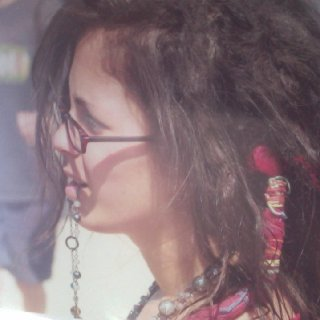 The two dreads that are wrapped in string are my friends dreads that i dreaded into my hair:)