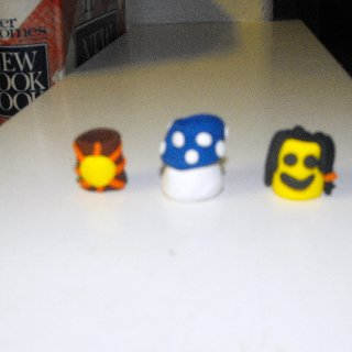 From left to right; Brown based bead with sun Blue mushroom Smiley dreadhead:)