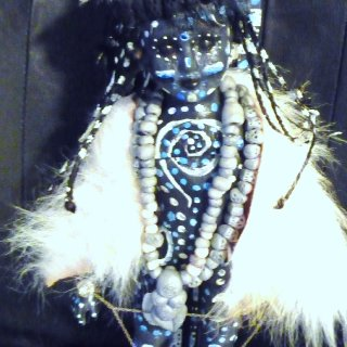 I am using my own handmade beads,faux fur,a recycled porcelain doll which I painted and sealed and much more