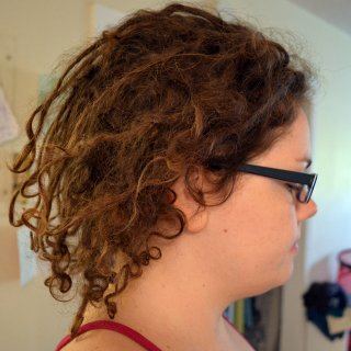 It's been 5 weeks since tnr. I've noticed a lot of shrinking as my curls are knotting up in shapes that remind me of celtic knots. I'm having a LOT less frizz issues, and my roots are knotting up well.