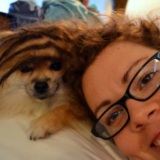 Playing with my pomeranian, Woobie. He was a little cranky from being woken up from his mid-morning nap just for a photo opp.