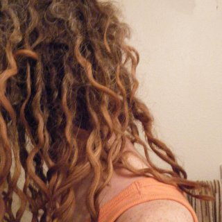 This is my second set of locks, five months in as of Feb 2013. Look at that riot of curls! My hair has really grown longer since my first set.