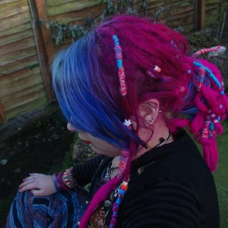So still had pink hair at this stage. We put some felt extensions on the end to make them longer as I lost so much length. Didn't help them knot much though