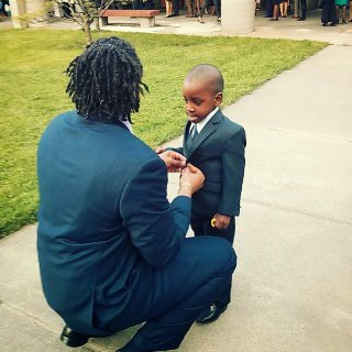 Me and my son getting ready to go receive my honor's cord.