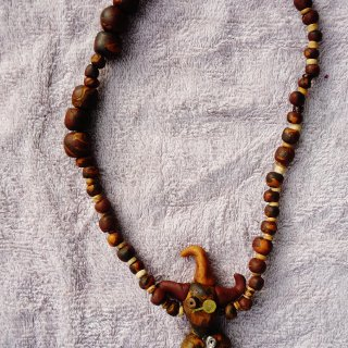 I created this necklace using my own handmade beads,stretchy cord,and found objects