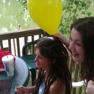 My daughters tied 3 or 4 helium balloons in my dreads..they had fun. They said this balloon was a light bulb..as in I had an idea.