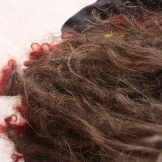 Quite a few dreads have been combed out, and now you can see quite a lot of loose hair floating about among the dreads.