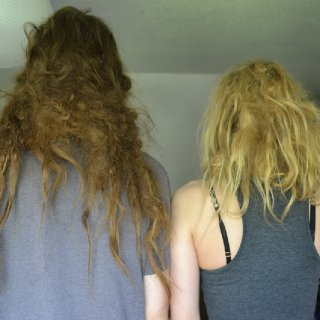 I guess we toss and turn a lot because the back is matting and shrinking considerably. On day 2, our hair was pretty stuck together so staying on top of it is vital. His hair was over 20 inches and he lost 6 in the back. I've lost about 4 inches in length so far. One month in and we have a few dreads! How exciting.
