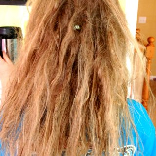Having to do a LOT of separating, her hair seems to want to be one BIG dread!