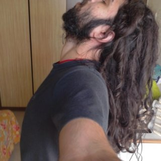 Over an year of not combing. Natural dreadlocks.