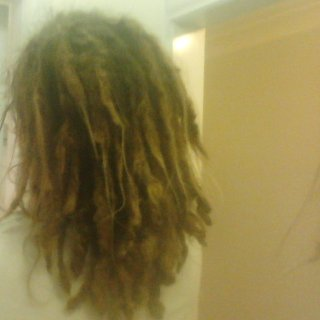 The back of my head. Since I started my dreads, They've grown about 5 inches.