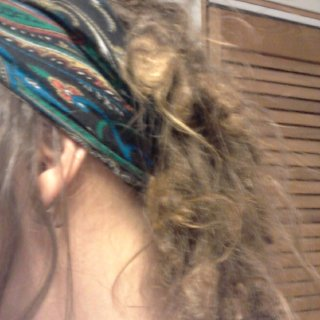 Bit blurry, but here are my 12 month natural/neglect dreads. Lots of medallions, still lots of flyaways and the sections at the front of my ears have mostly remained undreaded but are just starting to knot at the bottom.