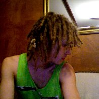 that white thing is some hemp i tied around 4 little dreads to combine them