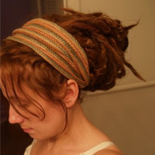 Just finishing my album with some last pics of my locks before 2010.  They are wrap snuggled naturally and tossed up in my dreadband.