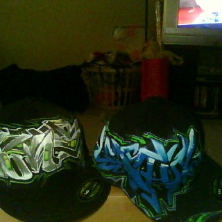 custom hand painted one of a kind fitteds- 40.00