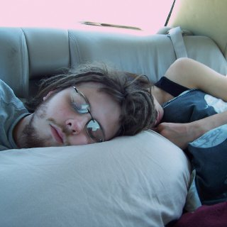 My mom took this pic of me and my brother sleeping on our way to california