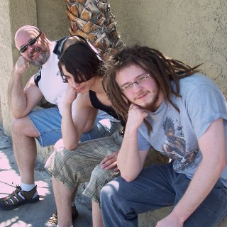Dad, Brother, and me thinking. lol