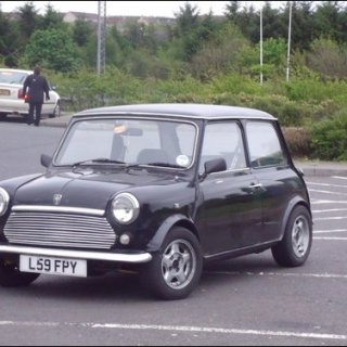 changed a bit now,, she now had checkered wing mirrors and white wheels ,,,,,, none of this bmw mini shite :P