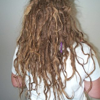 Now at the end of my 5th month of dreads and I love them. Lots of different things going on with them, loops to no end, zig zags, loose hair at the roots, a congo and lots of love going on there :-)