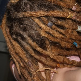 After combing/congo'ing at least a dozen of my thin dreads into thicker ones. Now I have 43. I had around 60 before.
