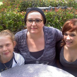 My daughters Hayven and Savannah with me at the Buddhist temple.