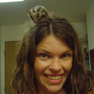 Me ten days in to the journey, with my friend Rustle. He is a sugar glider.